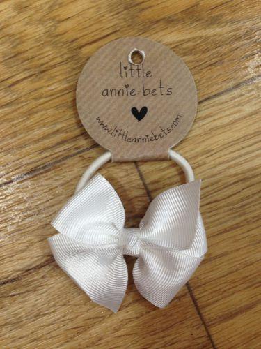 Little Annie Bets White Pinwheel Bow Hair Tie